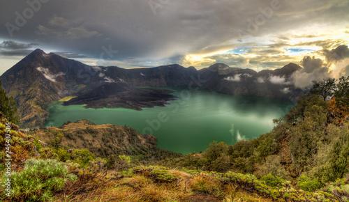 Fototapeta Mount Rinjani (or Gunung Rinjani) landscape at crater rim overlooking into crater lake and its volcanic mountain. Mountain Rinjani is an active volcano in Indonesia on the island of Lombok. obraz