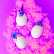 canvas print picture - Easter holiday concept with cute handmade eggs, set of kawaii cute unicorns eggs, trendy neon disco pink background