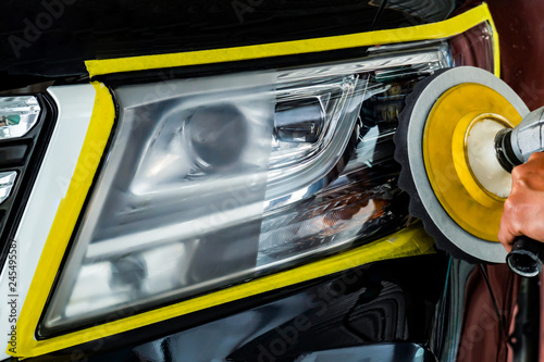 Obraz Car headlights with power buffer machine at service station - a series of CAR CARE - fototapety do salonu