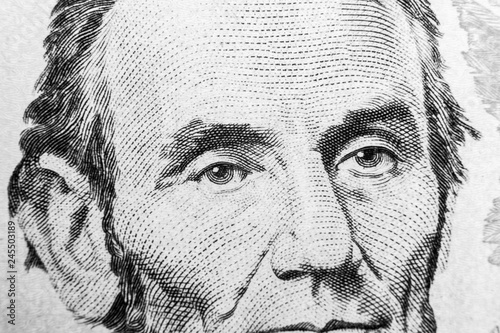 Photo  Close up view Portrait of Abraham Lincoln on the one five dollar bill