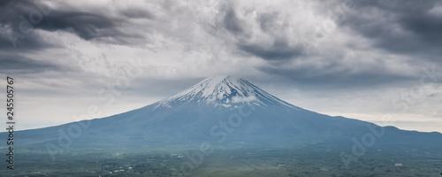 Foto auf Leinwand Blau Jeans Mount Fuji in Japan on a cloudy day