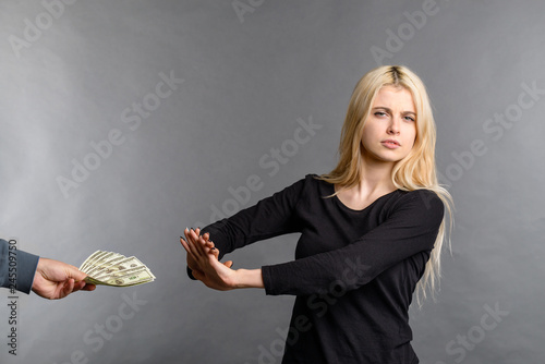 Valokuva  pretty blonde girl rejects money dollars banknotes woman does not take money, re