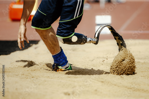 Fényképezés  amputee athlete with prosthetic in long jump competition