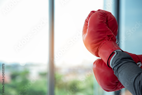 Valokuva  Close up of hands professional confident businessman standing with red boxing gloves
