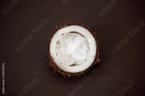 Fototapeta Half coconut on a dark background obraz na płótnie