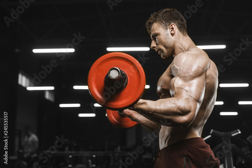 Fotografia Handsome strong athletic men pumping up muscles workout barbell curl bodybuildin