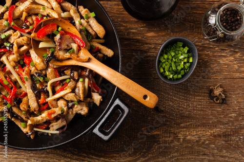Photo Pork chop with peppers, mushrooms and bamboo. Served with rice.