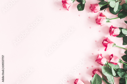 Flowers composition. Pink rose flowers on pastel pink background. Valentines day, mothers day, womens day concept. Flat lay, top view, copy space