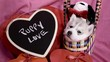 cute Valentines Day Husky puppy in a basket with Puppy Love sign being cute