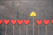 Red Hearts Made Of Paper Placed On Sticks And One Yellow Heart. Difference Or Individuality. It Is Worth Having Your Opinion. Stand Out From The Crowd And Different Creative Idea Concepts.