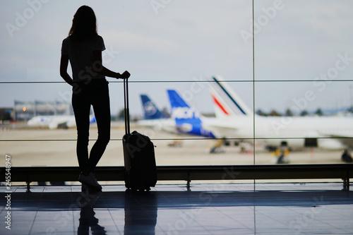 Fotografija  Young woman in international airport