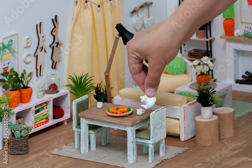 Cuadros en Lienzo A cheerful bright room in a doll house furnished with miniature furniture, A per