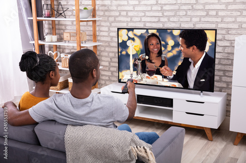 Fotografie, Obraz  Happy African Couple Watching Television