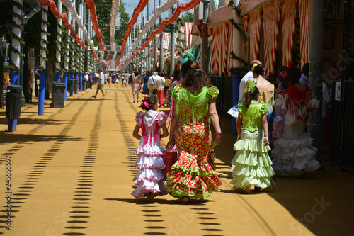 the families with the flamenco dress at Feria de Abril in Seville, Spain