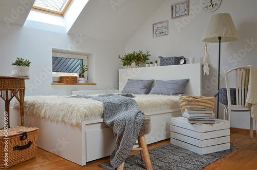 Obraz na plátně Cozy white scandinavian bedroom in the attic
