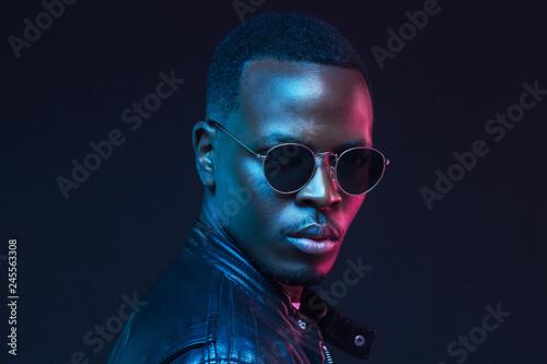 Fotografie, Obraz  African male model portrait, wearing trendy sunglasses and leather jacket