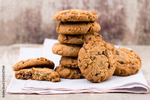 фотография Chocolate oatmeal cookies on the wooden background.