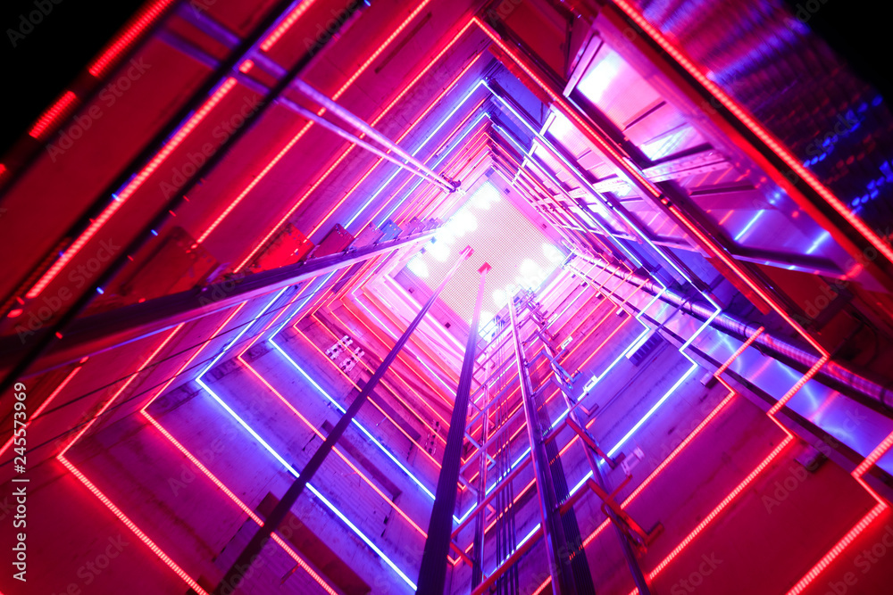 Fototapety, obrazy: Colorful illumination in a glass elevator