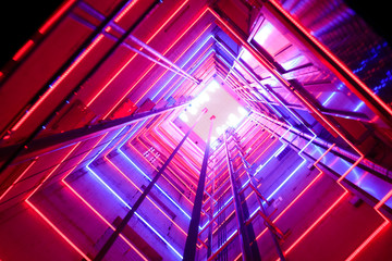 Colorful illumination in a glass elevator