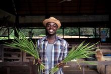 Smile African Farmer Man Holdi...