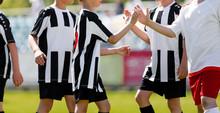 Kids Soccer Playersgive Each...