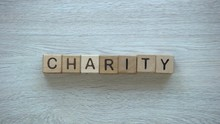 Charity, Hand Putting Word On ...