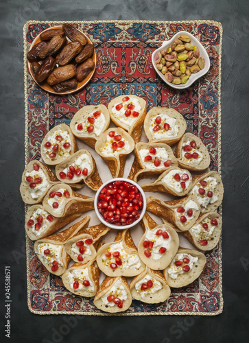 Pomegranate Qatayef Asafiri, Arabian pancake stuffed with sweet cheese.