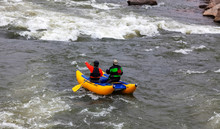 Two Rafters Approaching Rapids On The James River In Richmond, Virginia On A Bitter Cold Winter Afternoon.