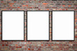 Leinwanddruck Bild - three blank picture frames on brick wall -  framed poster mock-up with stone wall background -