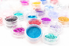 Small Colorful Jars Of Glitter...