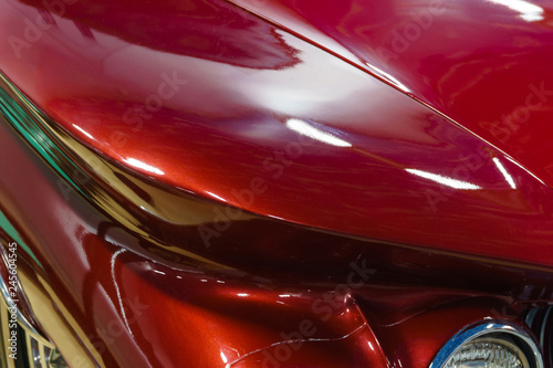Poster Vintage voitures background - fragment of the surface of body of a red vintage car