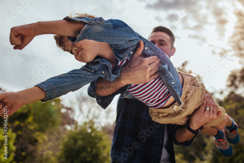 Father and son having fun at the park