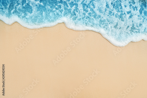 Background of Soft Blue Ocean Wave On Sandy Tropical Beach.