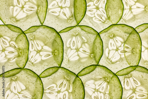 Pinturas sobre lienzo  very thin slices of fresh cucumber on white background