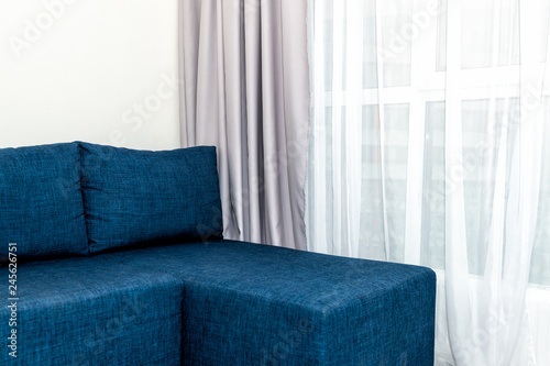 Modern Living Room Sofa With Window Blinds Curtains And Closeup Of Minimalist Blue Couch In Small Apartment Studio Interior Design And Nobody On Couch In Home Stock Photo Adobe Stock