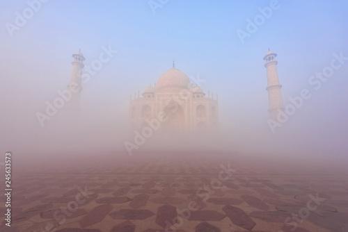 Deurstickers Asia land Taj Mahal in the fog at Indian city of Agra, Uttar Pradesh, India.