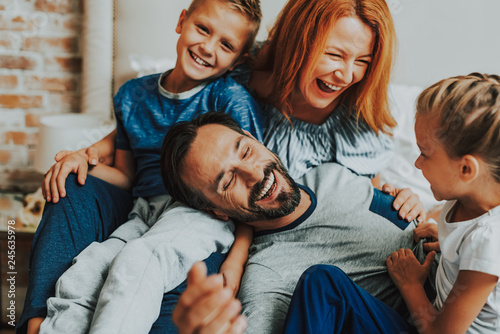 Fotografie, Tablou  Happy parents and two kids laughing together