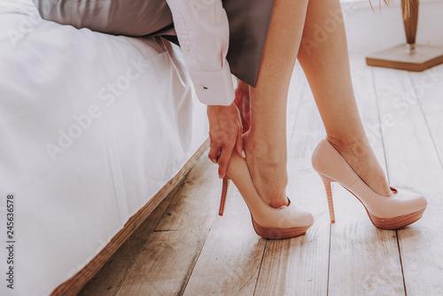 Valokuvatapetti Beautiful woman wearing high heels shoes on feet