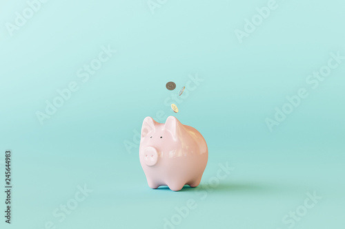 Fotografía Pink piggy bank with coins on pastel blue background