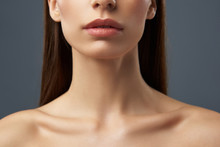Young Woman With Beautiful Full Lips And Graceful Neck