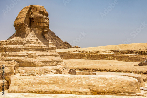 Photo Stands Egypt Egyptian Great Sphinx full body portrait head,with pyramids of Giza background Egypt empty with nobody. copy space