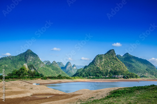 The mountains and river scenery with blue sky