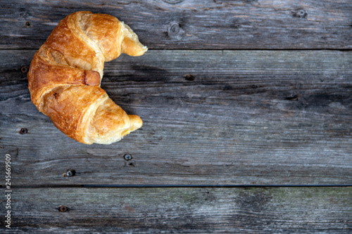 fresh french croissants on wooden ground Poster Mural XXL