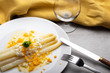 canvas print picture - cooked white asparagus with butter and boiled eggs