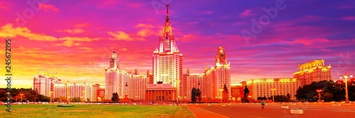 Dramatic vibrant wide angle panoramic evening view of illuminated famous Russian university