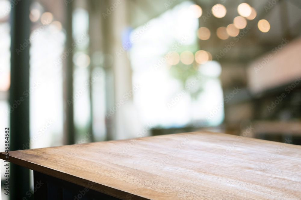 Fototapeta empty wood table with blur montage restaurant background