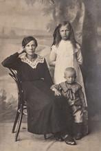 RUSSIA - CIRCA 1905-1910: A Portrait Of Young Woman With Children In Studio, Vintage Carte De Viste Edwardian Era Photo