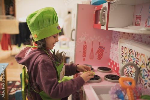 Cuadros en Lienzo little girl plays in toy kitchen