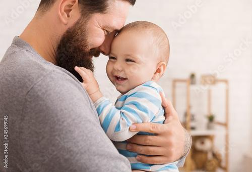 Fotografija Loving father embracing his cute baby son
