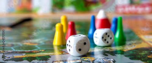 Fototapeta concept of board games. Dice, chips and cards on a green background long banner obraz